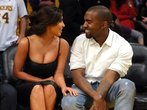 LOS ANGELES, CA - MAY 12: Kim Kardashian and Kanye West talk from their courtside seats before the Los Angeles Lakers take on the Denver Nuggets in Game Seven of the Western Conference Quarterfinals in the 2012 NBA Playoffs on May 12, 2012 at Staples Center in Los Angeles, California. (Photo by Noel Vasquez/Getty Images)