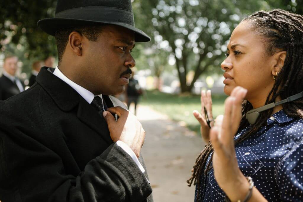 Left to right: David Oyelowo (as Martin Luther King, Jr.) discusses a scene with Director Ava DuVernay on the set of SELMA, from Paramount Pictures and Pathé.